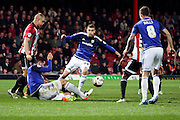 Cardiff City midfielder, Stuart O'Keefe (22) trying to create a chanmce in a crowded box during the Sky Bet Championship match between Brentford and Cardiff City at Griffin Park, London, England on 19 April 2016. Photo by Matthew Redman.
