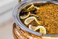 DUBAI, UAE - DECEMBER 11, 2015: Muhammar Rice is a traditional dish from Bahrain, cooked with spices and dates palm. It is often served as a side dish with fried or grilled fish. Zaman Awal signature restaurant offers Local, Gulf, and Fusion Cuisine.