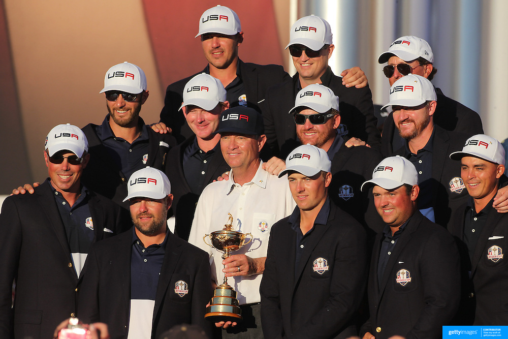 Ryder Cup 2016. Day Three. Davis Love III holding the trophy with the United States team after the United States victory over Europe in the Ryder Cup tournament at Hazeltine National Golf Club on October 02, 2016 in Chaska, Minnesota.  (Photo by Tim Clayton/Corbis via Getty Images)