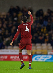 WOLVERHAMPTON, ENGLAND - Friday, December 21, 2018: Liverpool's Virgil van Dijk celebrates after the 2-0 victory during the FA Premier League match between Wolverhampton Wanderers FC and Liverpool FC at Molineux Stadium. (Pic by David Rawcliffe/Propaganda)