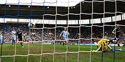 Alex scores the second goal past Coventry City's Kieren Westwood during the FA Cup Sponsored by E.ON 6th round match between Coventry City and Chelsea at the Ricoh Arena on March 7, 2009 in Coventry, England.