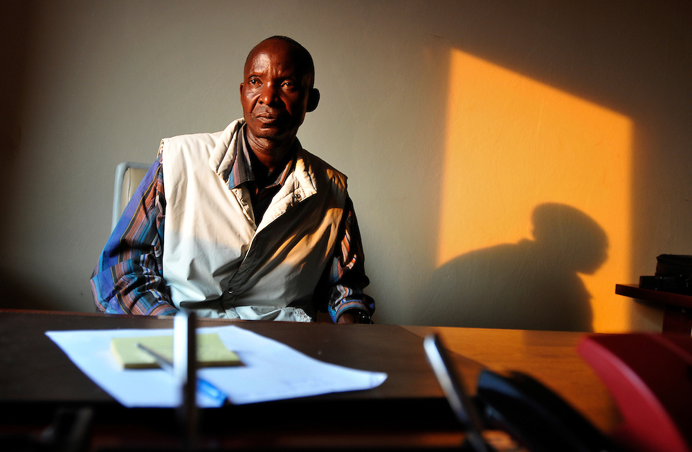 Castro Capitão, vice administrator of Liangango municipality in his office. The government is implementing the Village Reunification Program, a program encouraging the inhabitants of remote hamlets to move to larger villages so that the government can provide basic services like education, health care, water and electricity to the population. Landmines and other remnants of Angola's long civil war are preventing villagers from settling on safe land and inhibiting the long-term socio-economic development of the country..Liangongo, Angola. 29/09/2010.Photo © J.B. Russell