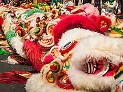 "08 FEBRUARY 2016 - BANGKOK, THAILAND: Lion dance outifts on the street before the Chinese New Year's parade Bangkok's Chinatown district, during the celebration of the Lunar New Year. Chinese New Year is also called Lunar New Year or Tet (in Vietnamese communities). This year is the ""Year of the Monkey."" Thailand has the largest overseas Chinese population in the world; about 14 percent of Thais are of Chinese ancestry and some Chinese holidays, especially Chinese New Year, are widely celebrated in Thailand.       PHOTO BY JACK KURTZ"