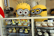 "The Minions visit Magnolia Bakery, Monday, Nov. 25, 2013, in New York, to celebrate the release of ""Despicable Me 2"" on Digital HD on November 26 and Blu-ray and DVD on December 10.  The Minions took over Manhattan in preparation for their appearance in the 84th annual Macy's Thanksgiving Day Parade.  (Photo by Diane Bondareff/Invision for Universal Studios Home Entertainment/AP Images)"
