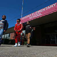 Students make their way to their buses as school dismisses at Verona Elementary School Tuesday. The oldest building of the complex is being considered to be torn down and rebuilt with a new facility.