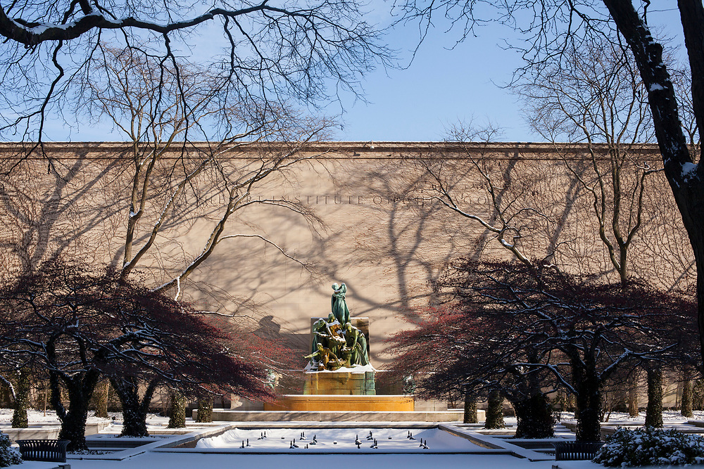 (Chicago, Illinois) - December 14, 2013 - The gardens of the Art Institute of Chicago are frozen with a layer of a fresh snow on a late December afternoon.