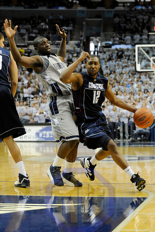12 January 2008:   University of Connecticut Huskies guard A. J. Price (12) is fouled by Georgetown University Hoyas guard Jessie Sapp (21) in the second half at the Verizon Center in Washington, D.C.  The Georgetown Hoyas defeated the Connecticut Huskies 72-69.