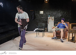 Danny Adcock, Noel Hodda, Jamie Oxenbould & Richard Sydenham rehearse with director Glynn Nicholas for Apocalypse Theatre's production of The Dapto Chaser, by Mary Rachel Brown, on Wednesday, 1 July, 2015.  The show takes place at Griffin Theatre from 1 - 15 July, 2015.  Photo by Robert Catto / robertcatto.com.<br /> <br /> For the Sinclair family, the cut-throat world of greyhound racing is a religion. And their beloved dog Boy Named Sue is more than a greyhound; he's their heart and soul on four legs. With the crucial Winnebago Classic on the horizon, Cess Sinclair has one shot at reversing his family's fortunes for good. Against all the odds, he's betting on a miracle.<br /> <br /> The Dapto Chaser is warts-and-all Australian comedy that gets its hands dirty with the adrenaline, sweat and guts of the dog racing sub-culture. The Sinclairs are a family trapped in the pressure cooker of gambling addiction and when things don't go to plan, they are forced to gamble the most important commodity of all – their relationship to each other.<br /> <br /> Playwright Mary Rachel Brown wrote The Dapto Chaser perched in the bleachers track-side, while director Glynn Nicholas will be going on an all-schnitzel diet to get it over the line.<br /> <br /> CREATIVE TEAM<br /> Director: Glynn Nicholas<br /> Producer: Dino Dimitriadis<br /> Set and Costume Designer: Georgia Hopkins<br /> Lighting Designer: Toby Knyvett<br /> Sound Designer: Daryl Wallis<br /> Stage Manager Cara Woods