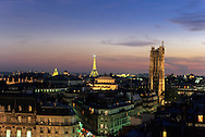 France. Paris. Elevated view on Paris cityscape and the Eiffel tower. Saint jacques tower. the eiffel tower and panoramic view  view from the dome of the bazar de l'hotel de ville       The Eiffel Tower and Tour St.-Jacques stand illuminated against a colorful sky at twilight in Paris. Tour St.-Jacques was once the tower of the Boucherie church.. Before to publish an image of the Eiffel tower lighting you should contact SETE; Mr Dieu at +33144112399 particularly for advertinsing.