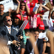 A member of Republican presidential candidate Donald Trump's team shoots t-shirts out of a gun during a rally at the Central Florida Fairgrounds in Orlando, Florida USA  02 Nov 2016