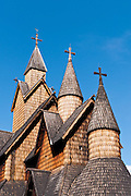 "Turret towers rise on Heddal stave church, Norway's largest stave church. This triple nave stave church, which some call ""a Gothic cathedral in wood,"" was built in the early 13th century and restored in 1849-1851 and the 1950s. Heddal stavkirke is in Notodden municipality, Telemark County, Norway."