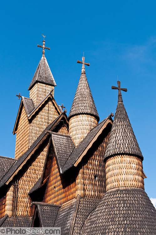 """Turret towers rise on Heddal stave church, Norway's largest stave church. This triple nave stave church, which some call """"a Gothic cathedral in wood,"""" was built in the early 13th century and restored in 1849-1851 and the 1950s. Heddal stavkirke is in Notodden municipality, Telemark County, Norway."""