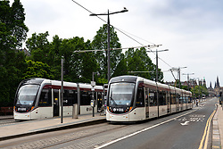 Edinburgh trams at stop on Princes Street, Scotland, UK