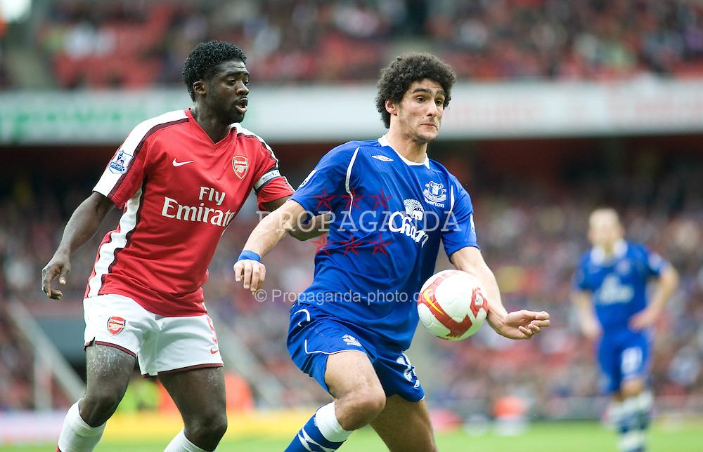 LONDON, ENGLAND - Saturday, October 18, 2008: Everton's Marouane Fellaini and Arsenal's Kolo Toure? challenge for the ball during the Premiership match at the Emirates Stadium. (Photo by Gareth Davies/Propaganda)