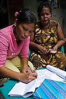 Women running a microfinance saving and credit scheme, Tallo, Makassar, Sulawesi, Indonesia.