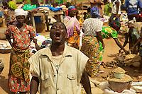 guy in a public market, Benin, West Africa