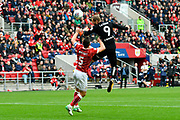 Pierre-Michel Lasogga (9) of Leeds United leaps above Bailey Wright (5) of Bristol City to head the ball during the EFL Sky Bet Championship match between Bristol City and Leeds United at Ashton Gate, Bristol, England on 21 October 2017. Photo by Graham Hunt.