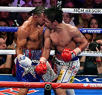 LAS VEGAS, NEVADA - JULY 20. <br /> Manny Pacquiao (R) buts heads Keith Thurman during their fight for the WBA welterweight title fight at MGM Grand Garden Arena on July 20, 2019 in Las Vegas, Nevada. Pacquiao went 12 rounds and took the win by a split decision.  (MB Media)