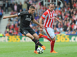 Stoke City's Charlie Adam chases down Liverpool's Jordan Henderson- Photo mandatory by-line: Nizaam Jones/JMP - Mobile: 07966 386802 - 24/05/2015 - SPORT - Football - Stoke - Britannia Stadium - Stoke City v Liverpool - Barclays Premier League