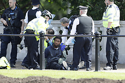 © Licensed to London News Pictures. 24/05/2017. London, UK. Police detain  a man outside Buckingham Palace just before the Changing of the Guard ceremony. The terrorism threat level has been raised to critical and Operation Temperer has been deployed. 5,000 troops are taking over patrol duties under police command. Photo credit: Peter Macdiarmid/LNP