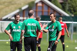 14.07.2013, Walchsee, AUT, FC Augsburg, Trainingslager, im Bild shake hands nach dem Abpfiff, v.li. Wolfgang BELLER (Co-Trainer FC Augsburg), Stefan REUTER (Geschv&szlig;ftsfv&int;hrer Sport FC Augsburg). Markus WEINZIERL (Trainer FC Augsburg) // during a trainings session of German 1st Bundesliga club FC Augsburg at their training camp in Walchsee, Austria on 2013/07/14. EXPA Pictures &copy; 2013, PhotoCredit: EXPA/ Eibner/ Klaus Rainer Krieger<br /> <br /> ***** ATTENTION - OUT OF GER *****