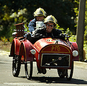 The PFB fire engine vehicle complete firefighters with competes in the 2009 PDX Adult Soapbox Derby running down Mt. Tabor on a windy course through the park.