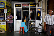 A Tamil woman tends to her child while waiting at a phone booth at Erode Junction stn., Tamil Nadu on 9th July 2009.. .6318 / Himsagar Express, India's longest single train journey, spanning 3720 kms, going from the mountains (Hima) to the seas (Sagar), from Jammu and Kashmir state of the Indian Himalayas to Kanyakumari, which is the southern most tip of India...Photo by Suzanne Lee / for The National
