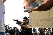 Matt Roth/Novus Select.Thursday, March 22, 2012..Members of the media photograph a small group of sign toting protesters before the 7pm start of the Trayvon Martin rally held at Fort Mellon Park in Sanford, Florida Thursday, March 22, 2012..Rev. Al Sharpton spoke at the rally for the slain black teen who was unarmed and shot after an altercation by neighborhood watch volunteer George Zimmerman, who pursued Trayvon on foot after being told not to by 911 dispatchers. Zimmerman has yet to be arrested because of Florida's Stand Your Ground Law.