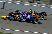Patrick Carpentier and Alex Barron race at the Kansas Speedway, Kansas Indy 300, July 3, 2005