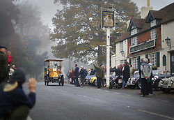 © Licensed to London News Pictures. 01/11/2015. Staplefield, UK. A 1902 De Dion Bouton passes through Staplefield during the London to Brighton Veteran Car Run.  Photo credit: Peter Macdiarmid/LNP