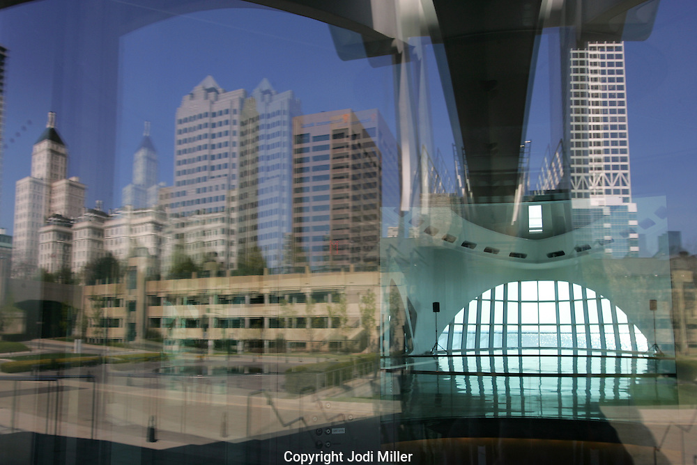 The reflection of the city Milwaukee in the glass of the museum of art.