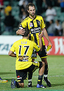 Wellington Phoenix's  Andrew Durante consoles his team mate Vince Lia after loosing to the Perth Glory during the A-Leagues minor semi final held at nib Stadium, Perth, Australia on Saturday 7 April 2012. Photo Theron Kirkman / Photosport.co.nz