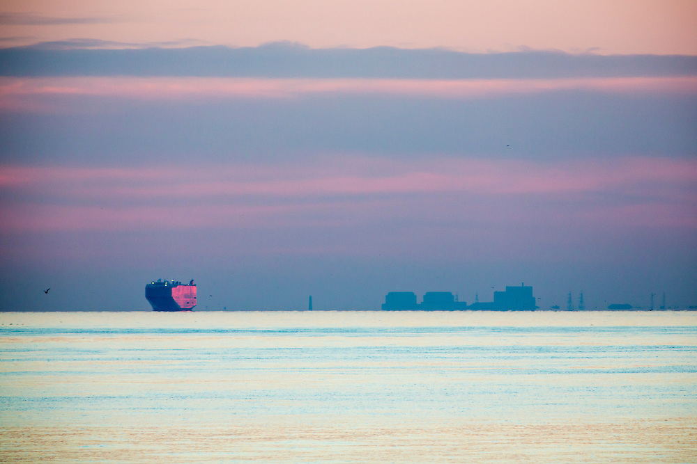 A large shipping container boat anchored in Hythe bay due to bad weather in The English Channel at sunset with Dungeness Nuclear Power Station in the background as seen from Folkestone, Kent, England, United Kingdom. <br /> (photo by Andrew Aitchison / In pictures via Getty Images)
