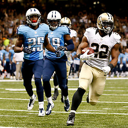 Aug 15, 2014; New Orleans, LA, USA; New Orleans Saints running back Mark Ingram (22) scores a touchdown against the Tennessee Titans during second quarter of a preseason game at Mercedes-Benz Superdome. Mandatory Credit: Derick E. Hingle-USA TODAY Sports