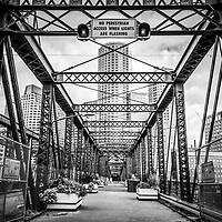 Boston Northern Avenue Bridge black and white photo. Old Northern Avenue Bridge was built in 1908 and spans the Fort Point Channel. Boston Massachusetts is a major city in the New England region of the Eastern United States. Copyright ⓒ Paul Velgos with All Rights Reserved.