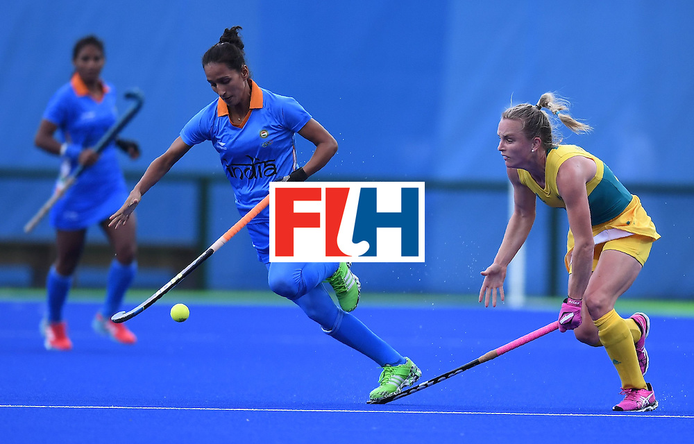 India's Preeti Dubey (C) and Australia's Jane-Anne Claxton vie for the ball during the women's field hockey India vs Australia match of the Rio 2016 Olympics Games at the Olympic Hockey Centre in Rio de Janeiro on August, 10 2016. / AFP / MANAN VATSYAYANA        (Photo credit should read MANAN VATSYAYANA/AFP/Getty Images)