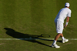 LONDON, ENGLAND - Monday, June 23, 2008: The shadow of Lleyton Hewitt (AUS) in action during his first round match on day one of the Wimbledon Lawn Tennis Championships at the All England Lawn Tennis and Croquet Club. (Photo by David Rawcliffe/Propaganda)