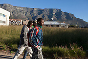 Arafat and friends walk to the library in central Cape Town. This is one of his favorite things to do. - Images from the Project South Africa: Working With Nonprofits workshop held in Cape Town, South Africa. Image © Steve Moakley/Momenta Workshops 2013.