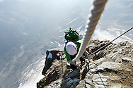 """An alpinist on the Hornli ridge.<br /> <br /> """"Matterhorn 150 years Cervino"""" - The year 2015 is the 150th Anniversary of the first ascent by Edward Whymper from the Swiss side (14th July) and by Jean Antoine Carrel from the Italian side on the 17th July 1865.<br /> <br /> On 17th July 2015 a friendship convention was signed by the members of Swiss, French, British and Italian climbing teams. A ceremony was held at the summit in honour of the mountain."""