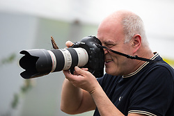 © Licensed to London News Pictures. 28/03/2018. London, UK. A photographer takes pictures of butterflies at the 'Sensational Butterflies' exhibition at the Natural History Museum, returning for it's tenth year. Photo credit : Tom Nicholson/LNP