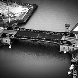 Chicago 95th Street Bridge aerial picture in black and white. The 95th Street Bridge was used in the draw bridge jump scene in the movie The Blues Brothers. The 95th Street Bridge is a bascule bridge located in Chicago's South Side and spans the Calumet River. Aerial picture was taken in 2013.
