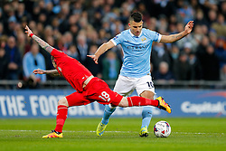 Sergio Aguero of Manchester City is challenged by Alberto Moreno of Liverpool - Mandatory byline: Rogan Thomson/JMP - 28/02/2016 - FOOTBALL - Wembley Stadium - London, England - Liverpool v Manchester City - Capital One Cup Final.