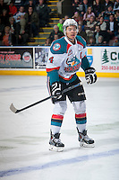 KELOWNA, CANADA - FEBRUARY 28: Madison Bowey #4 of Kelowna Rockets skates against the Calgary Hitmen on February 28, 2015 at Prospera Place in Kelowna, British Columbia, Canada.  (Photo by Marissa Baecker/Shoot the Breeze)  *** Local Caption *** Madison Bowey;