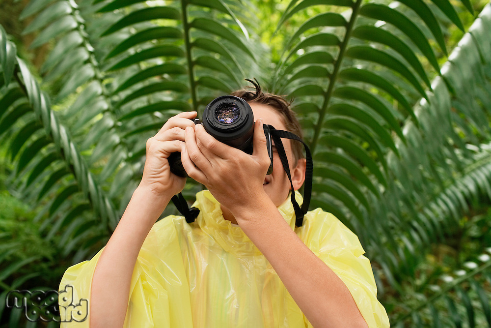 Boy Taking Photos in Forest