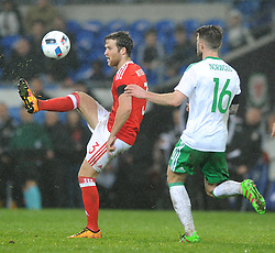 Adam Matthews of Wales clears the ball under pressure from Oliver Norwood of Northern Ireland - Mandatory by-line: Dougie Allward/JMP - Mobile: 07966 386802 - 24/03/2016 - FOOTBALL - Cardiff City Stadium - Cardiff, Wales - Wales v Northern Ireland - Vauxhall International Friendly