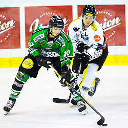 14.11.2014, Hala Tivoli, Ljubljana, SLO, EBEL, HDD Telemach Olimpija Ljubljana vs Dornbirner Eishockey Club, 18. Runde, in picture Gregor Koblar (HDD Telemach Olimpija, #20) vs Andrew Bombach (Dornbirner Eishockey Club, #16) during the Erste Bank Icehockey League 18. Round between HDD Telemach Olimpija Ljubljana and Dornbirner Eishockey Club at the Hala Tivoli, Ljubljana, Slovenia on 2014/11/14. Photo by Matic Klansek Velej / Sportida
