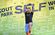 "Bob Harper, trainer on ""The Biggest Loser,"" leads thousands of attendees in a body-blasting workout at SELF magazine's 21st annual Workout in the Park, Saturday, May 10, 2014, in New York's Central Park.  (Photo by Diane Bondareff/Invision for SELF/AP Images)"