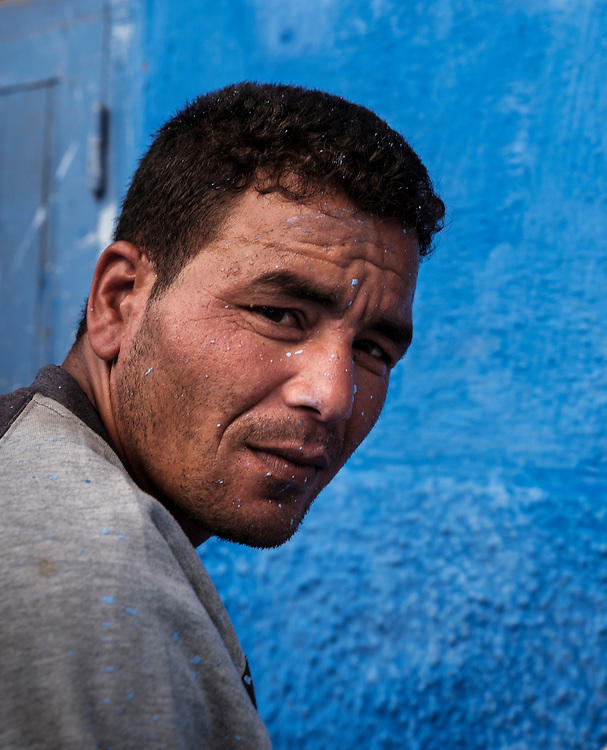 CHEFCHAOUEN, MOROCCO - CIRCA APRIL 2017: Portrait of Moroccan man in the streets of Chefchaouen with paint on his face