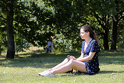 © Licensed to London News Pictures. 22/08/2019. London, UK. Maria enjoys the warm and sunny weather in London's Hyde Park. According to the Met Office, the temperatures are forecast to increase to 30 degrees celsius over the bank holiday weekend. <br /> <br /> ***Permission Granted***<br /> <br /> Photo credit: Dinendra Haria/LNP