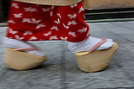 Miehina, a 20 year old maiko ( an apprentice geisha) from the Miyagawacho district of Kyoto walks in the street wearing her traditional 'geta' shoes, Japan. May 18th 2008.
